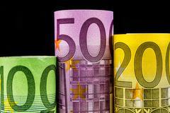 Podium made of big euro banknotes Stock Photos