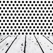 white wooden floor and black dots on white front - stock photo