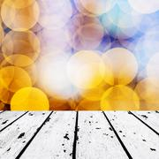 White wooden floor and blurred orange lights front Stock Photos