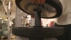 Replacing weights at the gym Stock Footage