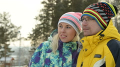 Young couple looking somewhere on winter day Stock Footage