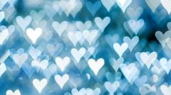 Bokeh of lights on defocused background in a form of heart Stock Photos