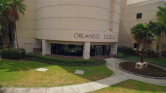 Aerial of Orlando Science Center Building & Entrance Exterior Stock Footage