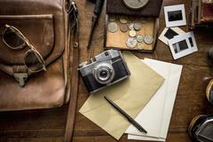 Still life of group of vintage objects on table - stock photo