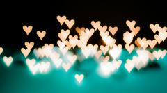 Beautiful bokeh of lights on defocused background in a form of heart Stock Photos