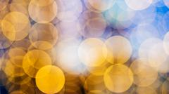 bokeh of warm orange lights on defocused background - stock photo