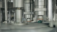 Rotating machines are moving bottles and pouring water Stock Footage
