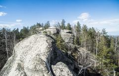 Elevated view of rock formation and forest - stock photo
