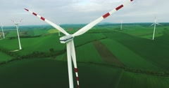 Aerial view of wind turbines on the Austrian field from drone Stock Footage