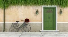 Country house with old door and bicycle Stock Illustration