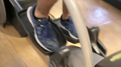 Elliptical training machine at the gym Stock Footage