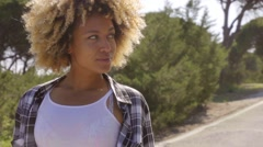Young Woman Looking Up to the Side on Sunny Day Stock Footage