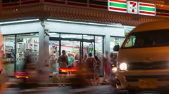Phuket, Thailand - May 2016: Time Lapse Seven Eleven store building exterior Stock Footage