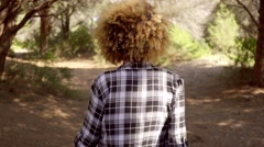 Woman in Plaid Shirt Walking on Forest Trail Stock Footage