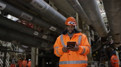 4K Portrait of engineer in power station looking at computer tablet.  Stock Footage