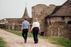 Young couple have fun near the medieval castle - stock photo