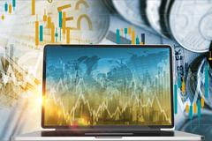 Forex and Stock Exchange Investing Concept with Laptop Computer. Stock Photos