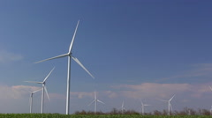 Wind turbines against blue sky Stock Footage