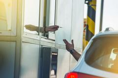 Paying Highway Toll. Men in the Car Paying the Toll. Highway Systems. Stock Photos