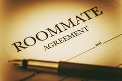 Roommate Agreement Signing. Sharing Living Space Legal Agreement. - stock photo