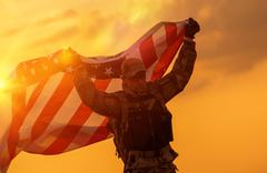 Soldier Celebrating Victory Running with Large American Flag. Trooper with th Stock Photos