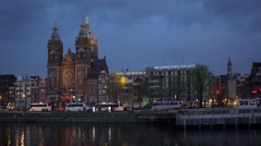 Amsterdam Canal Waterfront in the Evening - Basilica of St. Nicholas in 4K Stock Footage