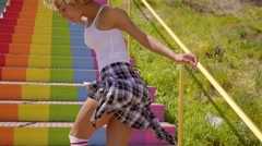 Young Woman Dancing On The Stairs. Stock Footage
