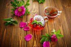 Fresh tea with rosehip Stock Photos