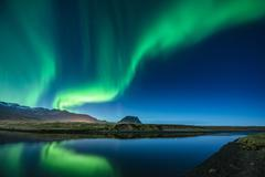 Aurora Borealis above Grundarfjordur, Mt. Kikjufell in centre, Snaefellsnes, - stock photo
