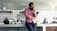 Sleepy, tired man drinking coffee in the morning in kitchen at home Stock Footage