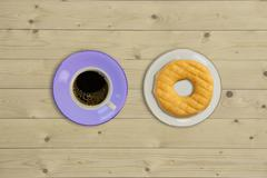 Overhead view of doughnut and a cup coffee Stock Photos