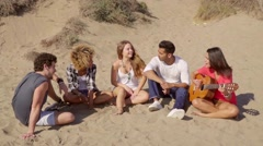 Group of young multiracial friends playing guitar - stock footage
