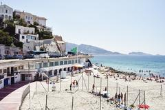 Crowds of holiday makers on beach, Marseille, France - stock photo