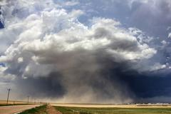 A massive supercell sucks up dust into the updraft leading to a violent dust - stock photo