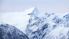 Snowy mountains in cold arctic environment - stock photo