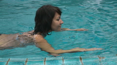 Attractive woman swimming in the pool Stock Footage