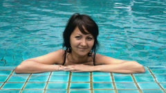 Attractive woman relaxing in the jacuzzi Stock Footage