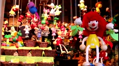 Showcases with moving toy clowns and angels on the Christmas market Stock Footage