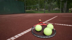 A tennis racket and some balls - stock footage