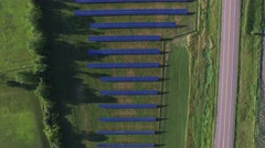 Aerial footage of a field of solar panels near, 4K, shot with a quadcopter or Stock Footage