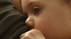 A baby breastfeeding from her mother, close up, drinking milk in slow motion - stock footage