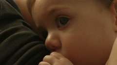 A baby breastfeeding from her mother, close up, drinking milk in slow motion Stock Footage