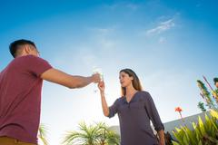 Couple toasting with champagne in penthouse rooftop garden, La Jolla, - stock photo