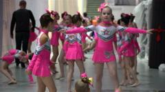 Little cheerleaders preparing for their performance backstage. - stock footage