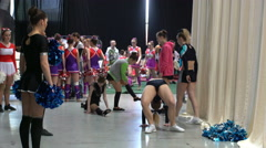 Younge cheerleaders preparing for their performance backstage. - stock footage