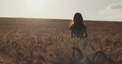 Girl standing happy in a golden field Stock Footage