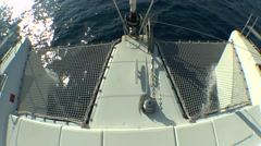 The bow of the sailing catamaran cutting waves. Stock Footage
