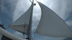 Sail of yacht against cloudy sky. Stock Footage