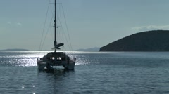 Sailing catamaran in the rays of the afternoon sun. Stock Footage