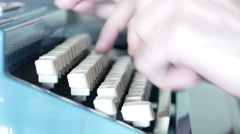 Hands typing on a typewriter Stock Footage